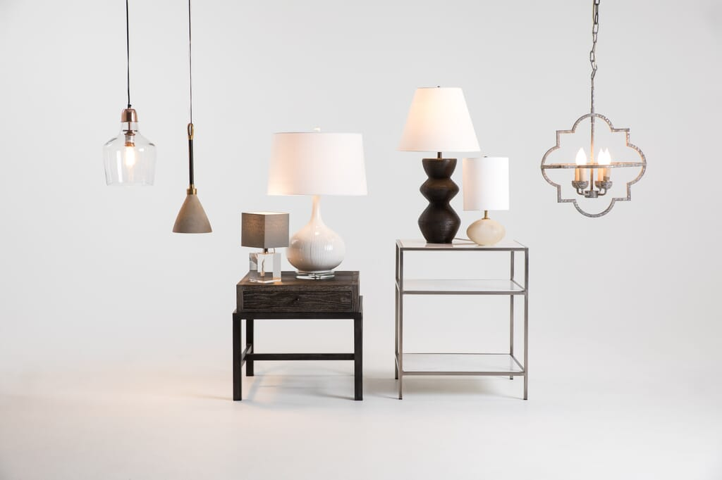 assorted table lamps and hanging lights against a white background