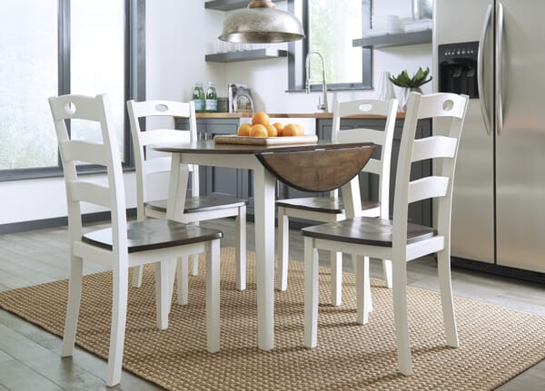 white 5 piece dining set with dropleaf table down in room shot